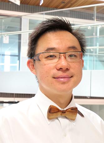 Dr Michael Tjeuw